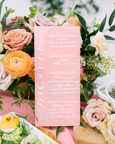 bright pink menu with white calligraphy adds a pop to this Easter table | Photography: Riley Starr
