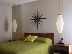 Love this mid-century style bedroom with the avocado bedspread and hanging lamps!