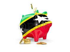 Hucha con monedas y con la bandera de San Cristóbal y Nieves. Saint Kitts and Nevis.