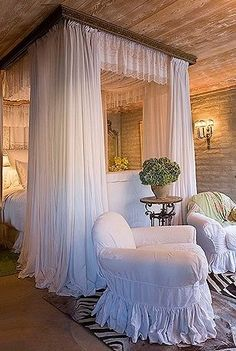 Lovely Bedrooom Decor...especially like the chippy paint on ceiling, the mortar on bricks not smoothed contrasted with  the pure, gathered, white linens and slipcovers...