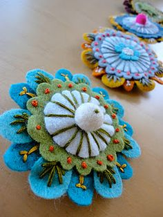 Like the idea of embroidering on felt for flowers, but I would change some of the colors.