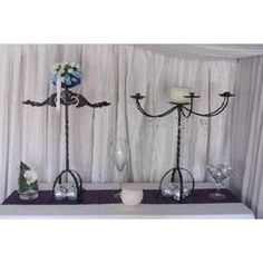 Large wrought Iron Candle Stands Available! Wrought Iron, Glass Vase, Candle Stands, Chandelier, Ceiling Lights, Candles, Vases, Events, Design