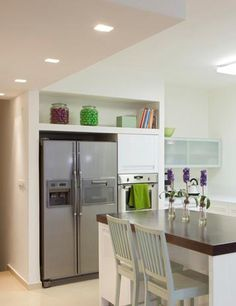 built-in display shelf above fridge (cabinets there never get used!)