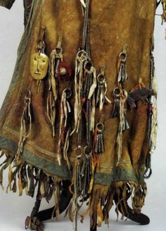 source and tribe unknown . Please share if you have information about the origin of this cultural attire.