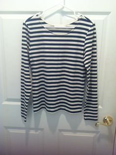 **SOLD**NWOT, Miss Love essential striped shirt, size large but works for busty mediums too, color of the stripes is a dark blue. I have this same shirt in another color, so deciding to swap this one.