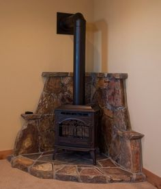Corner Wood Stove Ideas | few elements (like wall color ...