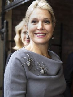 Queen Maxima wore two large brooches on her top in the shape of spiders