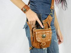 an adjustable purse with a gun holster, so you can wear it as a handbag, purse, thigh holster, shoulder holster, messenger bag, backpack, fanny pack, and protected purse