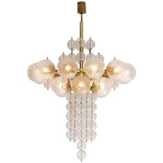 Large Chandelier in Brass with Structured Glass | From a unique collection of antique and modern chandeliers and pendants at https://www.1stdibs.com/furniture/lighting/chandeliers-pendant-lights/