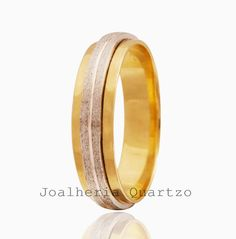 Aliança de casamento Greides, 7 gramas o par com detalhe em ouro branco.