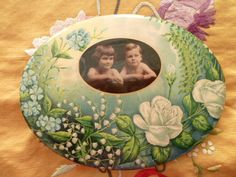 Antique Victorian Celluloid Portrait Photo of two Children Tin Metal Easel Button Floral Frame with Roses and Lily of the Valley