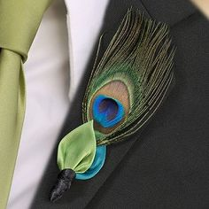 Peacock Wedding Boutonniere love this, sans the weird leaf looking thing