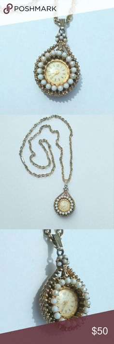 """Vintage Coro Movement Watch Pendant Necklace Check out this AMAZING, vintage, goldtone, 'pearl' accented, working movement watch,  pendant necklace by Coro! Minor wear to gold tone color on pendant and majority of pearly color has worn off faux pearls (adds to vintage charm,  imo). This is a battery free,  wind up,  movement clock that works after being against your body (it does work,  I just have not worn for sometime so needs to be warmed back up with a few wears). 24"""" chain…"""