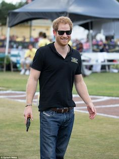 The Prince was seen wearing a pair of dark shades as he prepared to start the 200m race in...