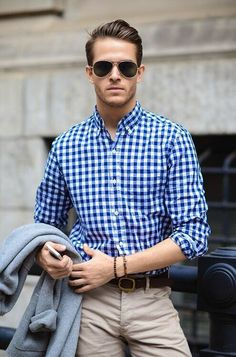 Blue and white checkered shirt with sand coloured shorts