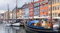 2. Denmark This country of very happy people has won the title of worlds happiest country three of the five times the report has been issued. These sailing boats at Nyhavn, a 17th Century waterfront canal and entertainment district in Copenhagen, are enough to make any visitor happy.