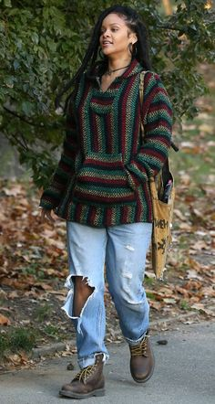 Rihanna on set wearing a striped Rasta hoodie. Get... | RIHANNA.STYLE