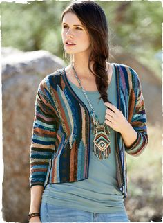 Shifting bands of color form a mirage on this striking pima cardigan from Kaffe Fassett. Handloomed in tweeded hues of midnight, cornflower blue, lilac, ochre, rose and chocolate with a v-neck, ¾-dolman sleeves, buttonless placket and handcrochet trim.