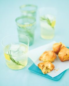 The cheesy, lemon-kissed artichoke mixture in these pastry pockets is inspired by the party favorite, hot artichoke dip. Serve it with Rosemary Vodka Tonics.