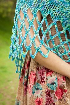 Close up view of the tall Tunisian crochet stitches that create the lacy filet border of the Ennis Shawl. New Tunisian filet crochet design by Vashti Braha in the upcoming Interweave Crochet magazine (Summer 2013 issue). Link goes to Crochetme, where yarn and other pattern details are listed.