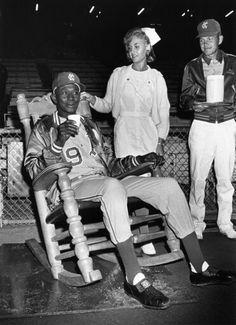 Satchel paige at baseball game .
