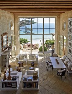 """Tangier Outlook is Richard Shapiro's seaside home in Malibu. Sited on a dramatic promontory, he built his fantasy of a Mediterranean villa – """"a centuries-old Moroccan aerie posed above the Strait of Gibraltar."""" Here his expert conjuring skills have imagined (and executed) a unique vision – where new and old coalesce into something timeless, something paradisiacal yet not specifically identifiable. Indoors and outdoors meld above, connected by a twenty foot high wall of windows and french…"""