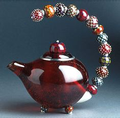 Pretty beaded teapot by Kristina Logan. (lovely blue & green ones on her site as well)