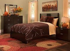 Bring home contemporary style with the Concorde 4-piece queen platform bedroom set. Its streamlined, modern look is beautiful in its simplicity—clean lines and a rich dark chocolate finish are enhanced with modest brushed silver drawer pulls, glass tops, and headboard and mirror slats that decorate without overwhelming.