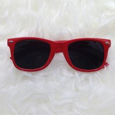 Red wayfarer like sunglasses Discounted Bundles ▪️Please use the offer feature  ▪️Ships within 24 hours ✈️ ▪️No tradesNo Paypal ▪️ Love the item but not the price?  Make an offer!  ▪️Condition - Great condition  ▪️Size - N/A ▪️Material - Plastic ▪️Description - Bright red sunnies with dark lenses and silver detail. I do not model eyewear ▪️Questions?  Don't be shy!  Feel free to ask  Accessories Sunglasses