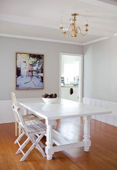 Why is this chandelier nailed to the ceiling?  Bring it down to join the rest of the furniture.... or are they trying to ignore it as it doesn't relate to the in style to the rest of the furnishings, art and accessories?