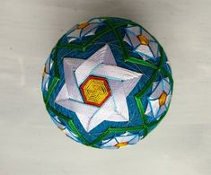 Temari (手まり) balls are a folk art form and Japanese craft that originated in China and was introduced to Japan around the 7th century A.D. Temari means hand ball in Japanese. Perfect gift for family and friends. Circumference: 32.5cm