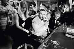 """Orson Welles And Table Gang  by Terry O'Neill  American actor Orson Welles (1915 - 1985) on the set of the James Bond spoof 'Casino Royale', 1967.  Limited Edition Silver Gelatin Signed and Numbered  12"""" x 16"""" / 16"""" x 20""""  20"""" x 24"""" / 20"""" x 30""""  24"""" x 34"""" / 30"""" x 40""""  40"""" x 60"""" / 48"""" x 72""""  For questions or prices please contact us at info@igifa.com  IGI FINE ART"""