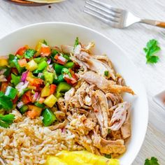 Slow Cooker Mojo Chicken and Rice Bowl Recipe Main Dishes with chicken, orange juice, lemon juice, salt, ground cumin, oregano, onion powder, garlic cloves, cayenne pepper, olive oil, black pepper, rice, pineapple, lime, salsa