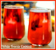 In a glass, add ice cubes, banana liqueur and raspberry liqueur & top with sprite! // #liqueur #cocktail #recipe