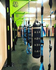 HIIT studio gym design. Group training for kickboxing, boxing, martial arts, and mma training. Using MoveStrong Functional Training Columns.