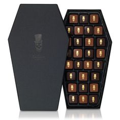 Dead Gorgeous Halloween Chocolates by Hotel Chocolat. This limited edition satin-trimmed coffin is filled with 28 milk and dark chocolates, each finished with 24 carat gold. To die for. Hotel Chocolate, Luxury Chocolate, Chocolate Brands, Chocolate Box Packaging, Chocolate Gift Boxes, Chocolate Treats, Chocolat Halloween, Halloween Chocolate, Halloween Coffin
