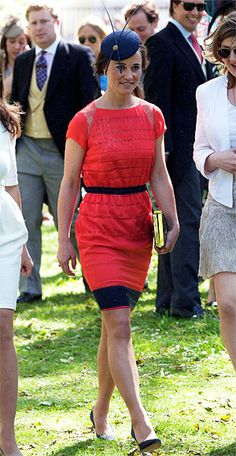 "Pippa Middleton attended a wedding in central London wearing a striped silk chiffon lace ""Lori"" dress in a pretty watermelon hue by British designer Catherine Deane. She finished the look with navy accessories, including a fascinator, box clutch, and pumps."