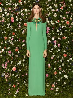 Green Gucci Dress 2013 resort collection in front of a wall of flowers
