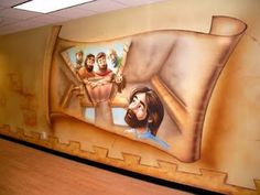 Worlds of Wow - friends help a man down through the roof to be healed by Jesus in this Bible story mural at McClendon Baptist Church.