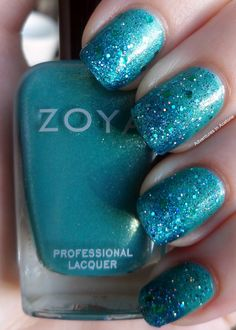 Orly Nail Defense  2 coats of Zoya Zuza  Ripped up damp makeup sponge and Zoya Charla for the tip gradient.  1 coat of Ozotic Elytra 528  I coat of Cult Nails Hypnotize Me  1 coat of Essence Edward