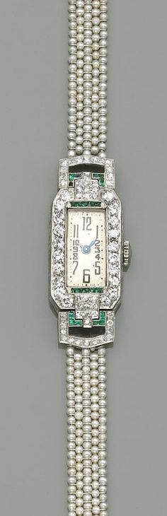 An art deco lady's, Swiss diamond, emerald and seed pearl wristwatch