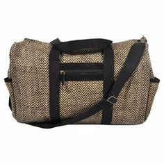 """Cotton-jute carry-all with a removable shoulder strap and multiple pockets.  Product: Carry-all toteConstruction Material: Cotton and juteColor: Black and naturalFeatures:  Fully linedZipper closureAdjustable and removable shoulder strap Two open side pockets One zippered front pocketDimensions: 14"""" H x 22"""" W x 8"""" DCleaning and Care: Professionally clean only"""