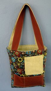yellow sweater turns into a bag (with pockets!)