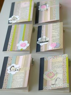 washi tape. Easily done with tape and scrapbook paper. Just have to find inexpensive little note books.