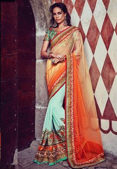 #Orange And #Cream And #Light #Blue #Net And #Georgette #Saree With #Blouse.  #Orange And #Cream And #Light #Blue #Net And #Georgette #Saree designed with #Heavy Zari,#Resham Embroidery With #Stone Work And #Lace Border.  INR: 7,283.00  With Exclusive Discounts  Grab: http://tinyurl.com/z427uvh
