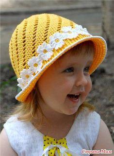 Uncinetto d'oro: Bellissimo cappellino co fiori !!!