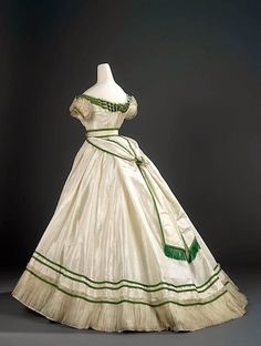 Charles Frederick Worth (1825 - 1895) Silk taffeta trimmed with bands of bright green silk satin, white silk lace and sheer silk tabby net.  1867