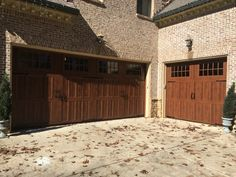 Steel carriage style garage door with Windows and decorative handles on high end hotels, high end skylights, high end fencing, high end construction, high end marketing, high end real estate, high end hardware, high end remodeling, high end steel doors, high end pantry doors, high end woodworking, high end skin care, high end security doors, high end electronics, high-end wood doors, high end bowling, high end roofing, high end cleaning services, high end railings, high end storm doors,