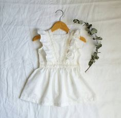 Our LOLA dress is a classic, vintage inspired dress made with cream embroidered cotton fabric and lace inserts. The perfect dress for upcoming festivities, or just another day. Front of dress is designed with a lace trim insert coming in like a V, creating a bib-look, whilst the back of