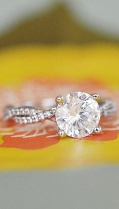 Love the  delicate strands of scalloped pavé diamonds on this stunning diamond engagement ring.